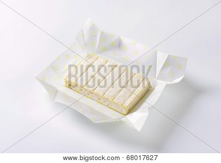 surface ripened cow's milk cheese in the paper wrapper