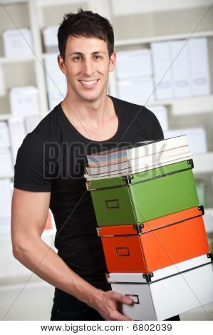 Man With Books And Boxes