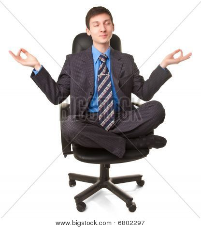 Young Man Sitting In Lotus Pose