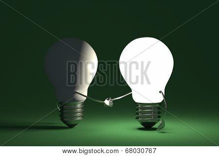 Light Bulbs Handshaking On Green