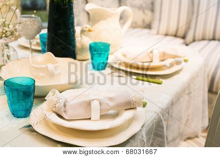 Served fashion table with glases and plates