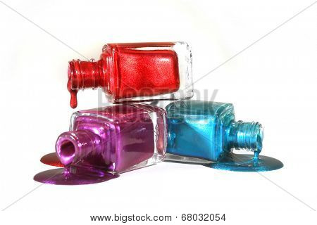 Salon Concept of Stacked Fingernail Polish of Red Blue and Purple