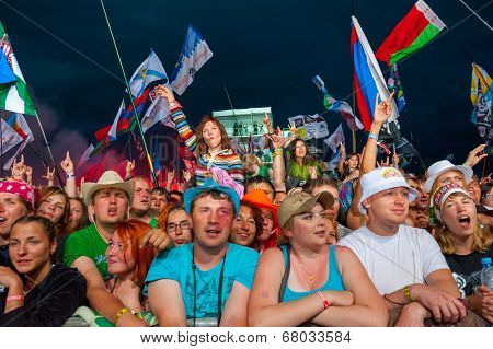 BIG ZAVIDOVO, RUSSIA - JULY 4: People cheering at open-air rock festival