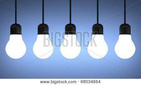 Hanging Glowing Tungsten Light Bulbs On Blue