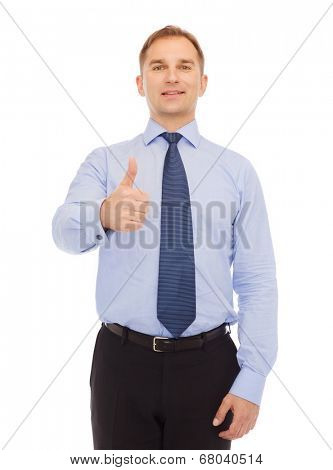 business, education, gesture and office concept - smiling businessman showing thumbs up