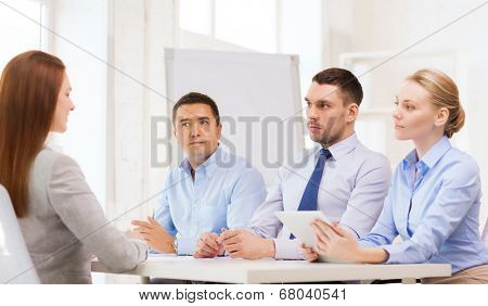 business, interview, employment and office concept - business team with tablet pc computer interviewing or firing worker in office