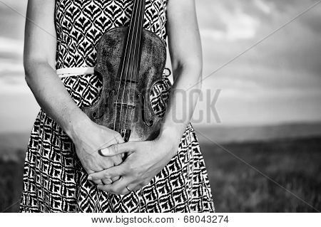 Female Violinist holding her violin - midsection