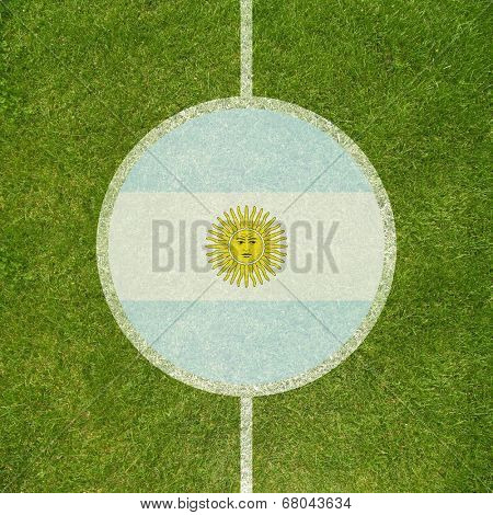 Football field center closeup with Argentinian flag in circle