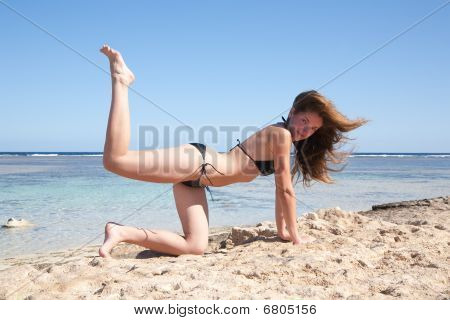 Fit Girl  Practicing Yoga At Sea Coast