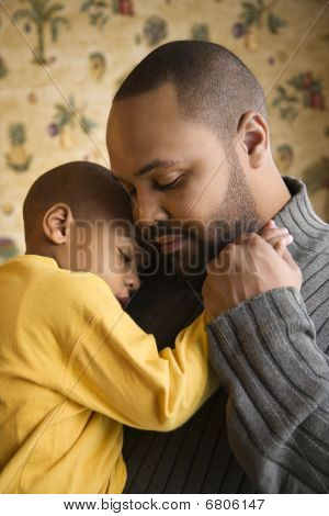Father Smiling Holding Young Son