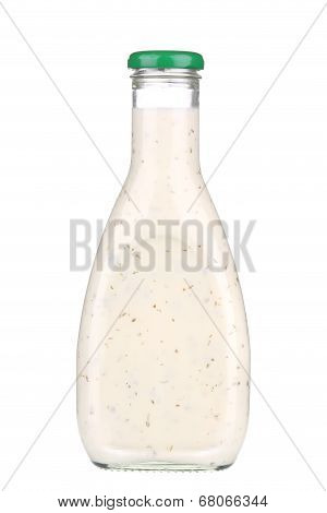 Glass bottle of white sauce.