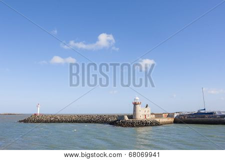 Lighthouse At The Harbour