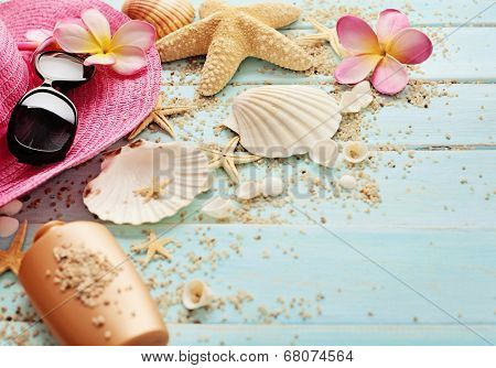 summer background with sunglasses and flip flops on wooden board