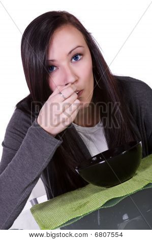 Beautiful Girl Eating Cereal