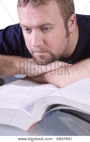 College Student With Books On The Table Daydreaming