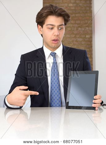 Businessman Pointing To A Tablet In Horror
