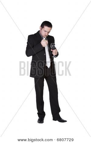 Businessman Celebrating With A Glass Of Drink