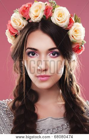 girl on a pink background with wreath