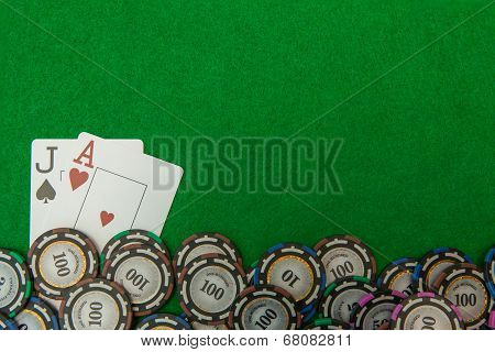 Jack and ace blackjack cards with chips on green background