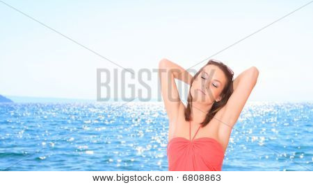 Beautiful Young Woman Relaxing By The Beach