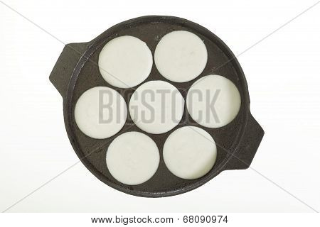 cooking Idly in idli pan.