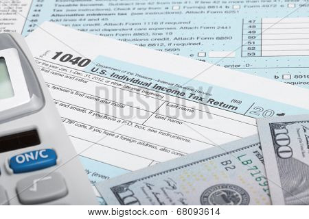 Us Tax Form 1040 With Calculator And 100 Us Dollar Bills