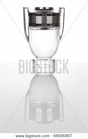 Goblet made of glass and silver isolated on white with reflection