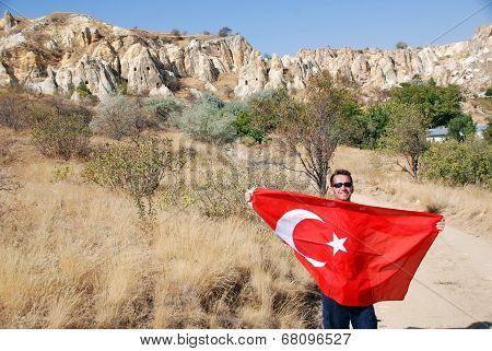 Man waving the Turkish flag