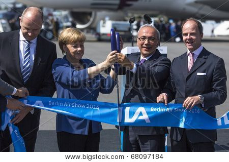 BERLIN, GERMANY - MAY 20, 2014: German Chancellor Angela Merkel, Turkish Minister of transport Lutfi Elvan and CEO Mr Christian (C.-R.) open up the International aviation and space exhibition ILA.