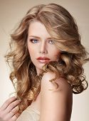 stock photo of blush  - Sophisticated Woman with Perfect Skin and Flowing Blond Healthy Hair - JPG