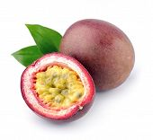 stock photo of passion fruit  - Passion fruit with leaves close up on white - JPG