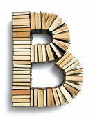 pic of hardcover book  - Letter B formed from the page ends of closed vintage hardcover books standing on a white background from a set or series of numbers - JPG