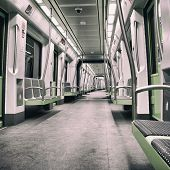 image of railroad car  - Inside a green empty subway car with filter effects - JPG