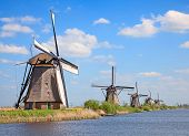 stock photo of windmills  - Ancient windmills near Kinderdijk - JPG
