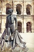 stock photo of bullfighting  - Roman Coliseum with a statue of a bullfighter - JPG
