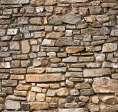 foto of wall-stone  - Brown tileable old stone wall texture - JPG