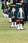 stock photo of kilts  - Line of military musicans in Kilts and sporrans