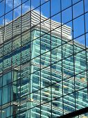 picture of skyscrapers  - Reflection of an office block skyscraper in glass windows in Birmingham - JPG