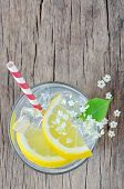 picture of elderflower  - elderflower juice with lemon on old table - JPG