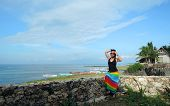 pic of filipina  - Filipina watching the ocean from a cliff resort