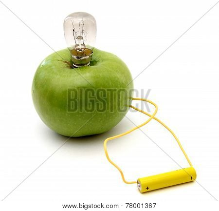 Green Apple With A Lamp Connected To A Battery
