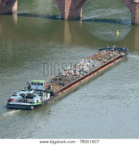 Barge transports waste on the river