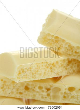 Tasty porous chocolate with empty white background