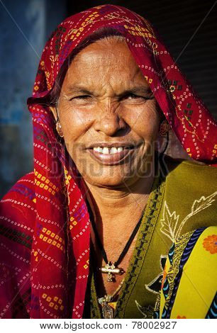 Indigenous senior woman smiling at the camera.