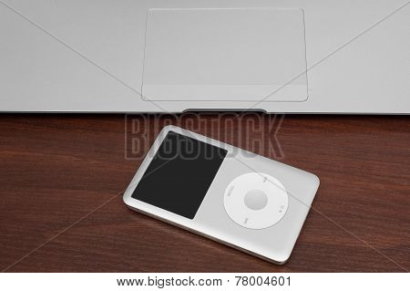 Ipod Classic 160 Gb On Silver Metal Laptop. Studio Shot, Isol