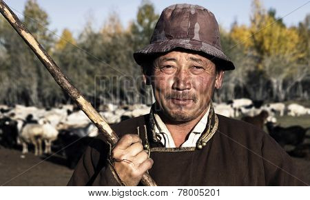 Portrait of mongolian man famer.