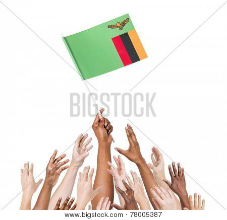Human hand holding Zanbia Flag among multi-ethnic group of people's hand