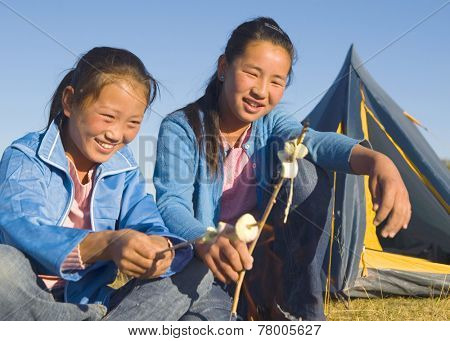 Mongolian Two siters anjoy camping.