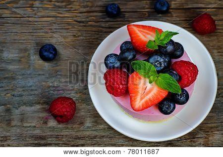 Souffle Cake With Fresh Raspberries, Blueberries And Strawberries