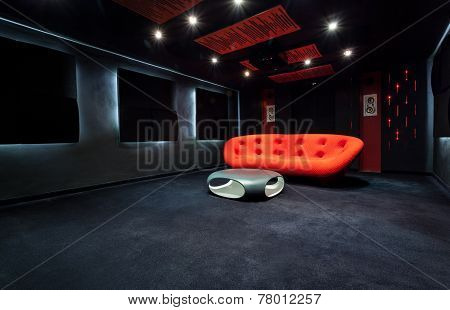 Red Sofa In Dark Room